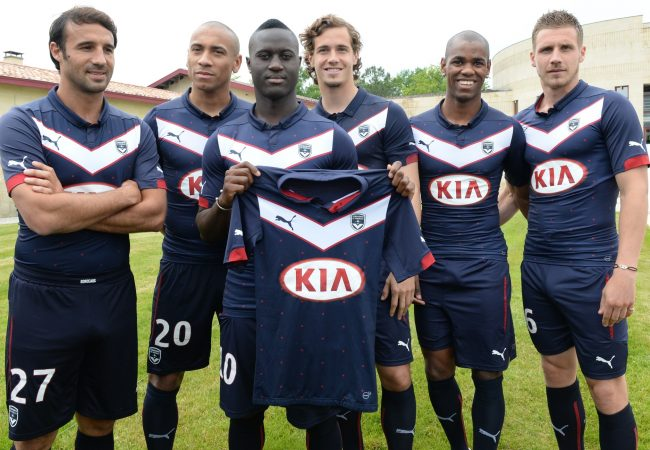 French L1 football club Girondins de Bordeaux' players (LtoR) Marc Planus, Ferreira Jussie, Henri Saivet, Lucas Orban, Diego Rolan and Gregory Sertic pose during the presentation of the new jersey of their team for the next 2014-2015 season on May 6, 2014 in Leognan. AFP PHOTO / MEHDI FEDOUACH        (Photo credit should read MEHDI FEDOUACH/AFP/Getty Images)